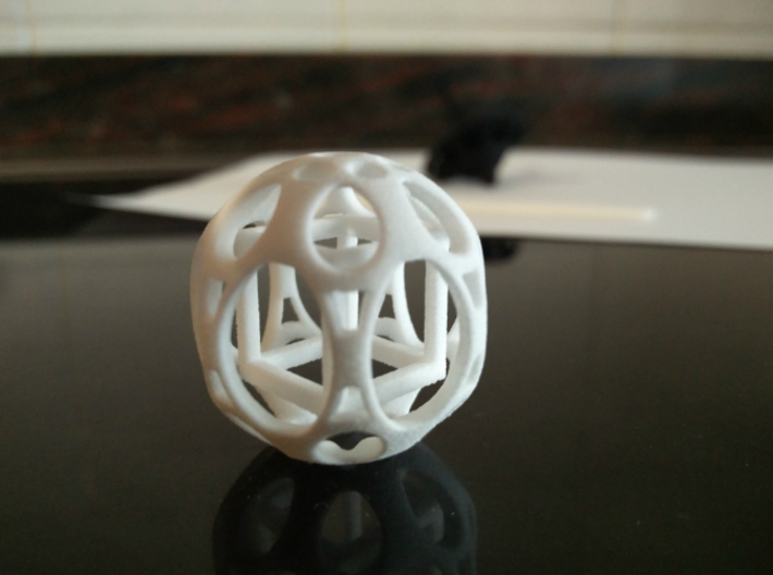 Sphere housing a mobile cube 3d printed Elegant in white