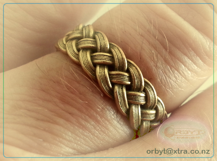 Best Celtic Knot Ring - US size 10 3d printed Smartphone camera pic of size 10 3D printed ring in raw brass material