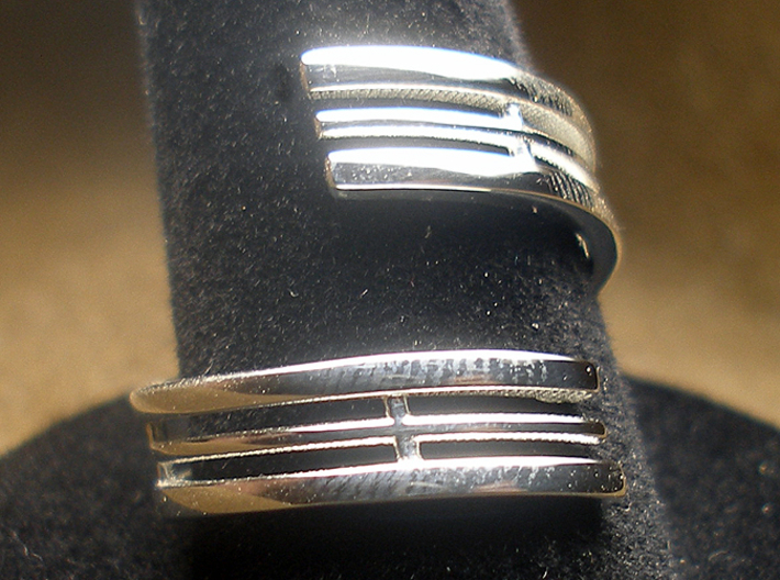Bars & Wire Ring Size 7½ 3d printed Photo of the ring on a ring stand, printed in sterling silver.