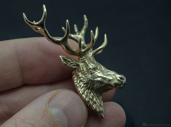 Deer head pendant 3d printed Bronze. Very beautiful and highly detailed