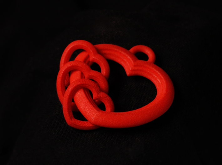 2 Hearts Linked in Love 3d printed Image shown with 3 hearts.