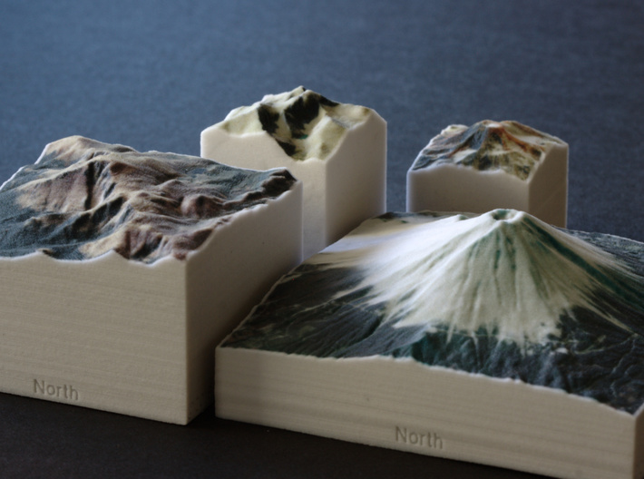Pikes Peak, Colorado, USA, 1:100000 Explorer 3d printed Pikes Peak next to Longs Peak, South Sister, and Mt Fuji, all Explorer models in the same scale