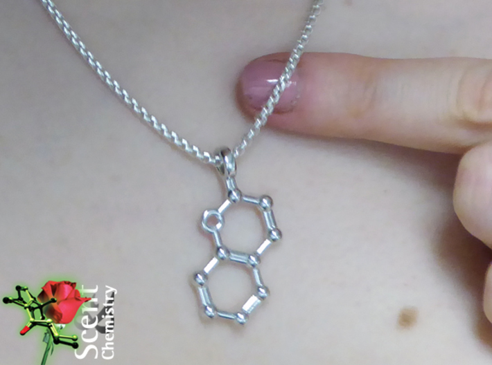Coumarin 3d printed Magnification of rhodium-plated coumarin pendant worn on a Thomas Sabo KE1107-001-12 .