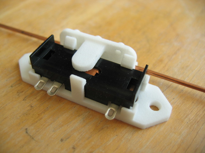 Railroad switch/point actuator PECO PL-13 (x9) 3d printed This shows how the bracket holds the PECO PL-13 switch.