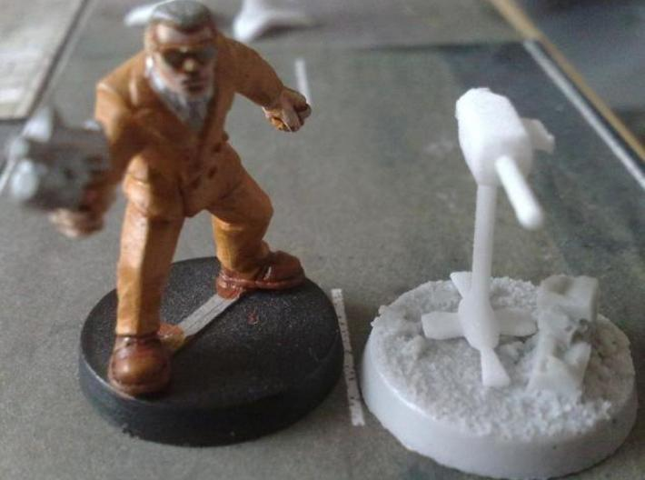Base defence guns 3d printed An unpainted base defence gun, with figure for size comparison. The base is from Dark Art Miniatures.