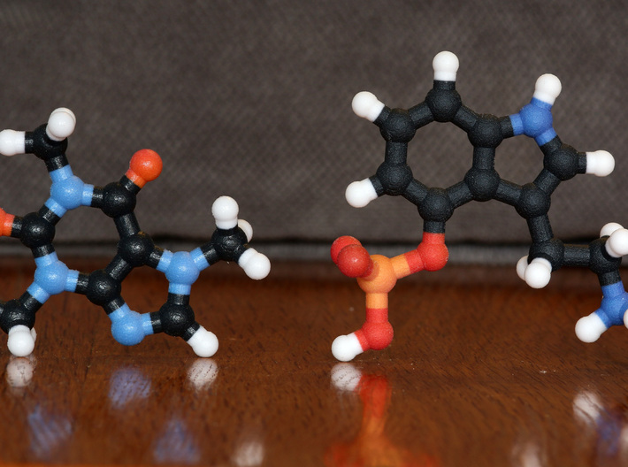 Caffeine / Coffee Molecule 3d printed Coated (left) and non-Coated (right) Full Color Sandstone. Coating gives a much smoother feel.