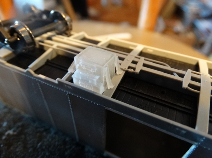 """""""State of Maine""""-style HO Charcoal Heater Kit 3d printed A """"d3"""" charcoal heater fitted beneath an Atlas boxcar.  The """"d3"""" bracing variation allows the heater to fit easily beneath a car with sloping underbody ribs!"""