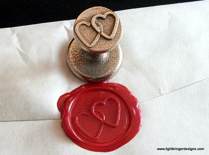 Linked Hearts Wax Seal 3d printed This is the seal and its impression in Red sealing wax.