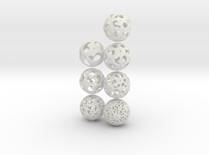 Comma symmetry spheres: 7 infinite families 3d printed