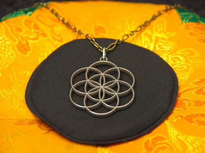 Seed of Life Pendant 3d printed Photo of Stainless Steel pendant on a chain.