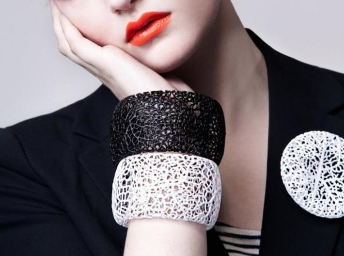 Rhizome Cuff 3d printed in black and white on model