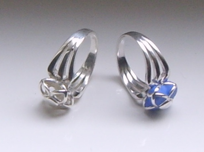 3-2 Enneper Curve Triple Ring (002) 3d printed On the right the ring has a Blue Polymer Clay infill