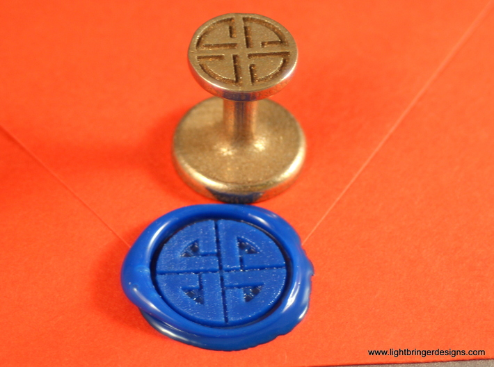 Shield Knot Wax Seal 3d printed Same as the first one, with Royal Blue wax on an orange envelope.