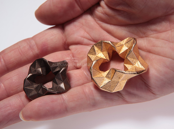 Impulse - Large 3d printed Left: Small size in polished bronze steel. Right: Large size in polished gold steel.