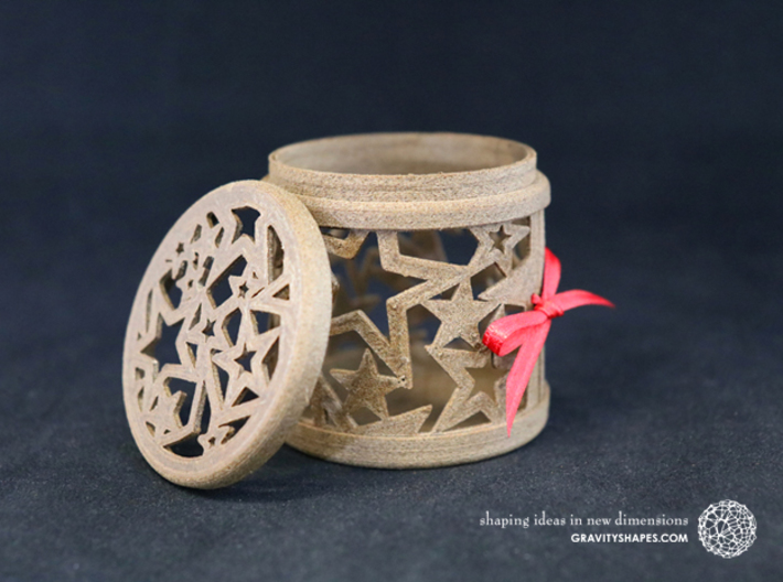 Gift Box No. 1 with Stars (filigree, high) 3d printed The photo shows an own print (FDM print) made of brown wood incl. decorative lacing.