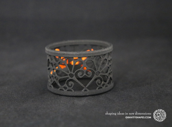 A large napkin ring with Mosaic-3b 3d printed The photo shows a print made of black strong and flexible incl. orange lacing.
