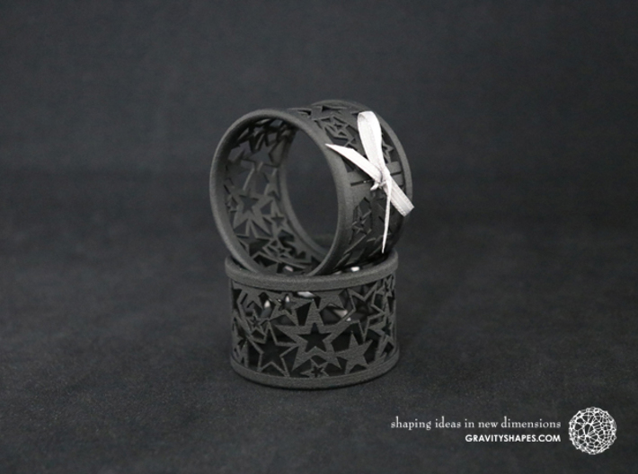 Set of 2 large Christmas napkin rings with Stars 3d printed The photo shows prints made of black strong and flexible incl. silver lacing.