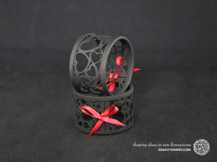 Set of 6 large napkin rings with Hearts 3d printed The photo shows prints made of black strong and flexible incl. red lacing.