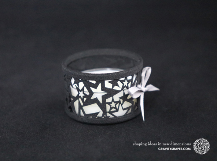Set of 2 small tealight holders with Stars 3d printed The photo shows a print made of black strong and flexible incl. silver lacing and a normal tealight candle.