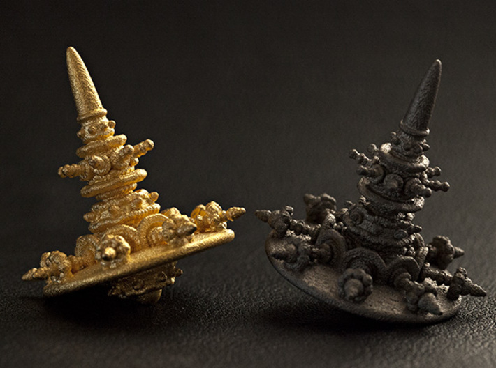 Spinning Top of Escaped Times 3d printed From left to right, Stainless Steel and Gold plated Polished Stainless Steel.