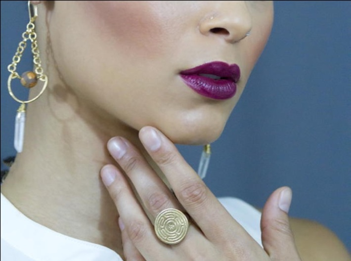 Wheel of Hecate ring 3d printed A professional model wearing the ring in raw brass; photo by Caralena Kopp http://cmkproduction.com