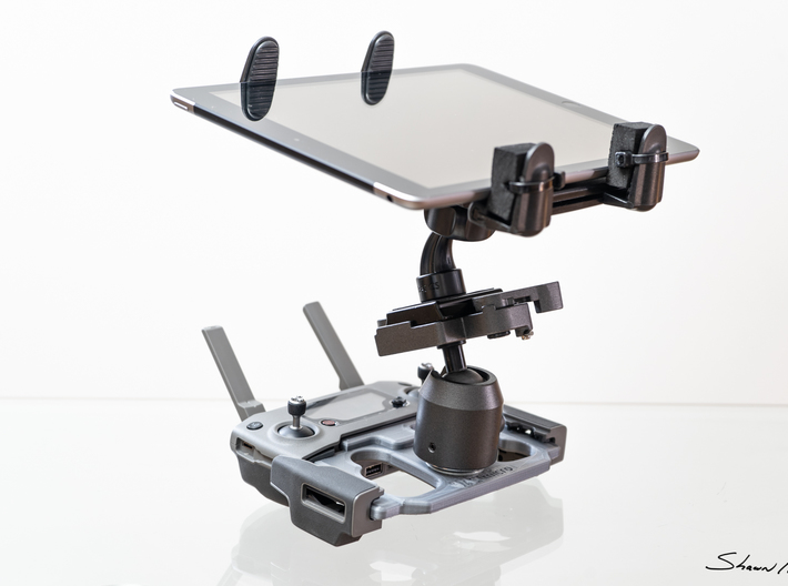 Mobile Device Mounting Plate for DJI Mavic Pro 2 C 3d printed One of many ways to mount a tablet. This is a variant of mine that I use. Example shown in Grey PLA is the one I use daily