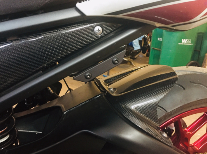 06-15 Yamaha FZ1 Passenger Peg Delete - flat 3d printed Black PA12 material. Almost has a metallic look to it.