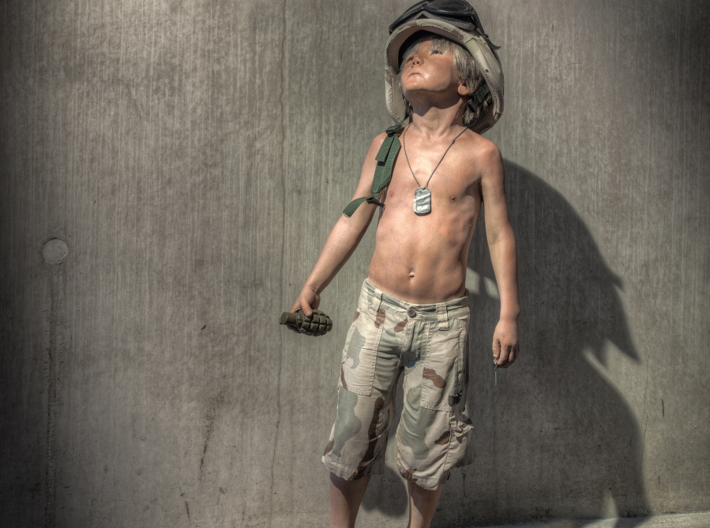 Boy Soldier Pendant 3d printed This Boy Solider has been seen all around the world and now you can get your own.