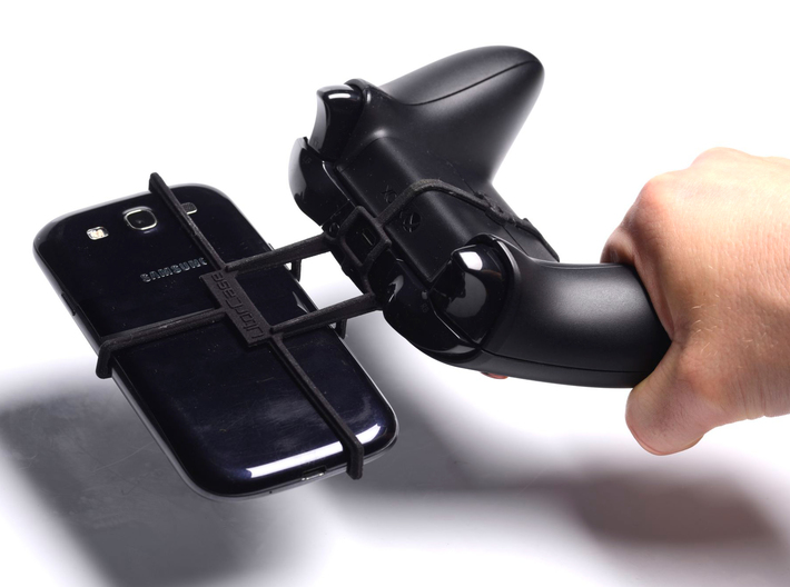 Xbox One controller & LG Optimus Vu II - Front Rid 3d printed In hand - A Samsung Galaxy S3 and a black Xbox One controller