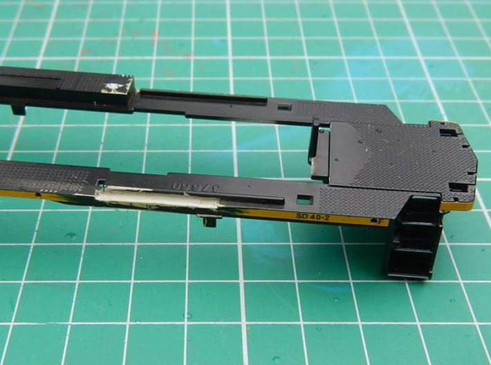 HO scale 1:87 CSX SD40-3 Wabtec Cab 3d printed Frame showing notch cut out for battery cover hinge.