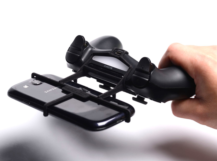 PS4 controller & Samsung Galaxy V 3d printed In hand - A Samsung Galaxy S3 and a black PS4 controller