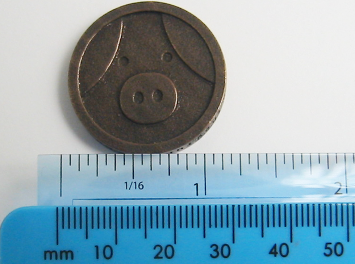 Pig Coin 3d printed Coin shown with metric and imperial scales. Coin is 30 mm,  approx 1 and 3/16th inches across