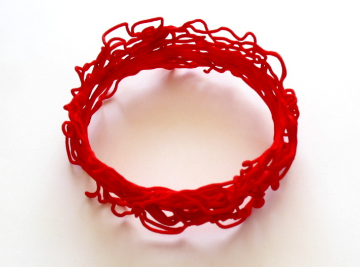 Turbulent Bangle 3 3d printed This bangle is printed in red strong & flexible polished. It is on display at the Oz gallery in Thornton, CO!