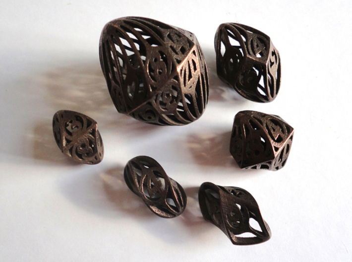 Twisty Spindle Dice Set 3d printed In Polished Bronze Steel