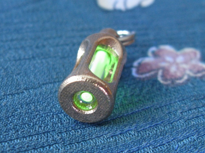 Tritium Earrings 3 (3x11mm Vials) 3d printed In this picture the phosphorus coating on the tritium vial is being energised by UV light.