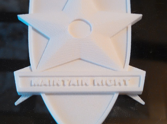 Main Force Patrol Badge (from the first Mad Max) 3d printed Print lines are visible on star and wings. This photo and the material tend to hide them.