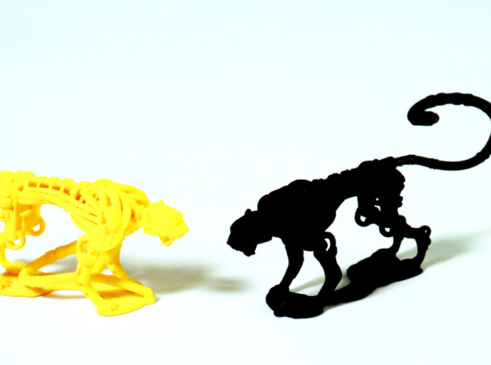 ~cheetah 2 Piece 50% 3d printed yellow has tail still attached to the base
