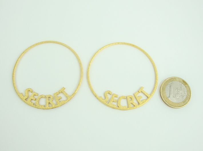 Custom Hoop Earrings - Secret 50mm 3d printed Polished Gold Steel with 1€ coin for scale.