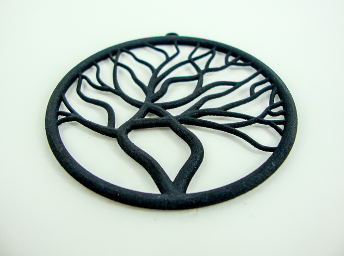 Tree Big Hoop Earrings 60mm 3d printed Tree Big Hoop Earrings 60mm printed in Black Strong & Flexible. Closeup from one earring.