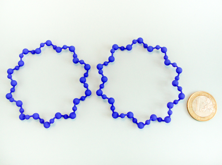 Molecule Big Hoop Earrings 60mm 3d printed Molecule Big Hoop Earrings 60mm printed in Blue Strong & Flexible Polished with 1€ coin for scale.