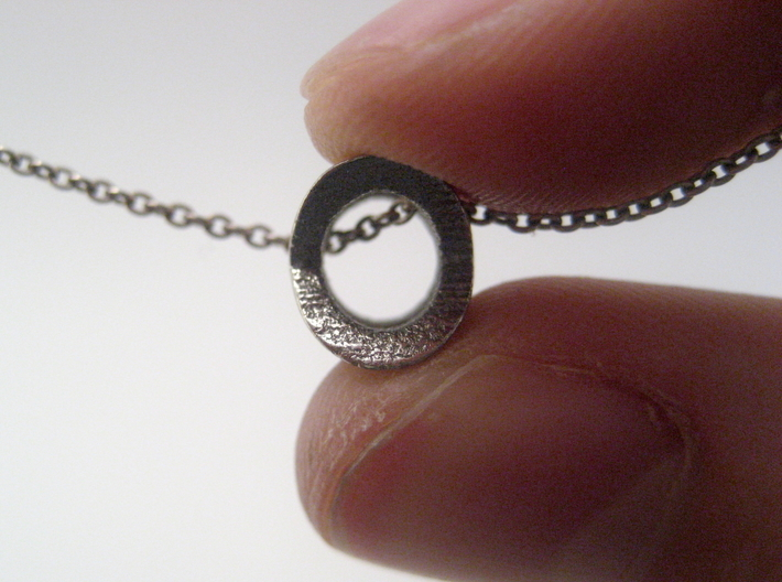 """Hugs And Kisses Pendant - Small Version 3d printed The """"O"""" can be seen from the side"""