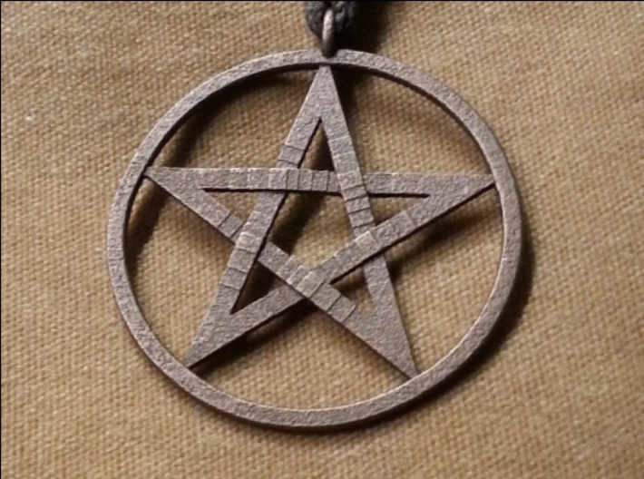 Pentacle Pendant - braided 3d printed The braided pentacle pendant in stainless steel. I designed this at a customer's request. This is the picture they took of their new pendant.