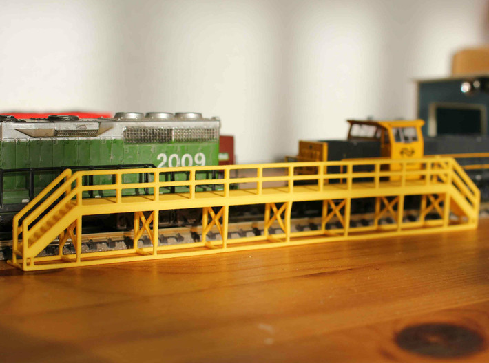 N Scale Train Maintenance Platform SINGLE STAIR RI 3d printed Train maintenance platform with two stairs in Yellow Strong & Flexible Polished, straight of the box. NB: the model in the picture differs from the one on this page.