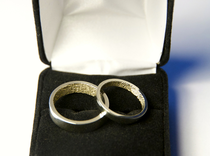 "Fingerprint Ring - Hers 3d printed The matching pair of rings: the 3mm ""hers"" and the 5mm ""his"" in 14k White Gold."