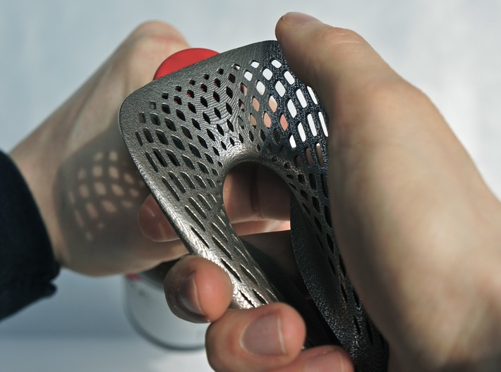 Zisch... Bottle Opener with perforated pattern 3d printed Stainless Steel