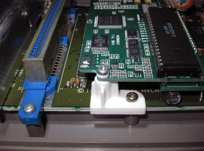 NESRGB PCB Standoff for AV Famicom 3d printed User supplied M3X9.5 screw with printed washer on top of PCB.