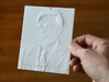 Alan Turing Shadowgram 3d printed Photo of the print lit from the front, revealing the relief