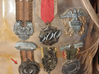 """Immortan Joe """"Grinder"""" Badge / Medal 3d printed A look at the medals on Immortan Joe's chestplate; this was used as a reference to create this model."""