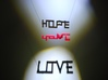 Hope and Love 3d printed Add light from 2 different angles and Hope and Love appear in the shadows!