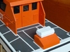 """Life Raft square 1/25 (1 pc.) 3d printed Life raft (this one in """"White, Strong & Flexible"""") placed at the stern of a pilot boat."""